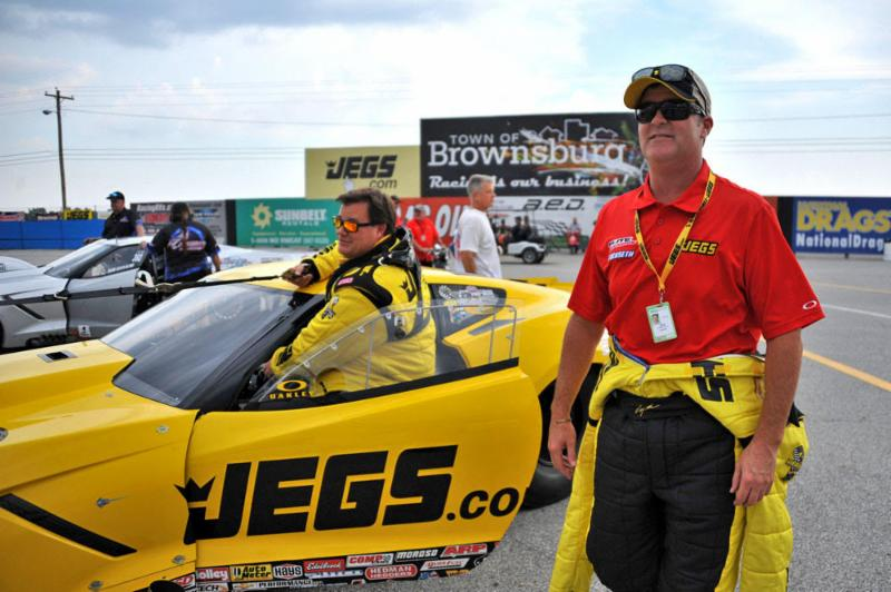 Troy Coughlin Sr., background, led the JEGS.com team during the second
